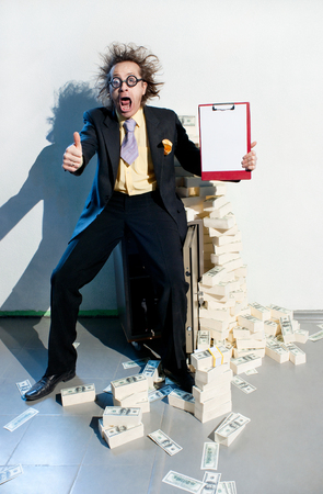 Crazy banker with bunch of money Stock Photo - 22701382