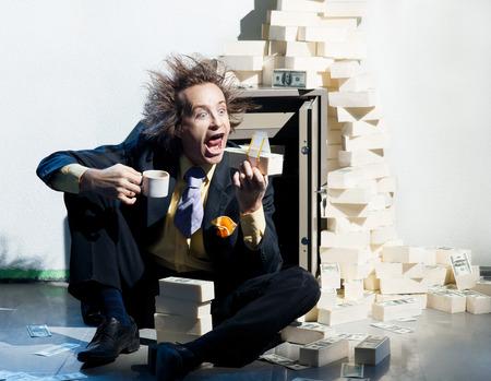 avidity: Greedy banker eats a wad of money