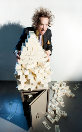Greedy banker with bunch of money Stock Photo - 22728941