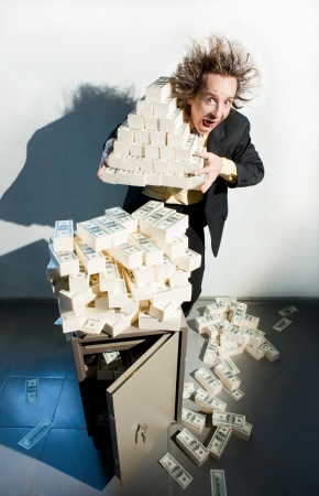 Greedy banker with bunch of money Stock Photo - 22728912