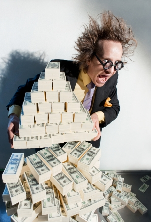 Greedy banker with bunch of money Stock Photo - 22728942