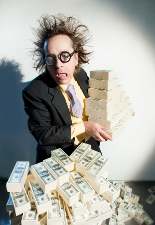 Greedy banker with bunch of money Stock Photo - 22853548