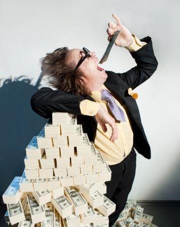 avidity: Greedy banker in glasses eats money