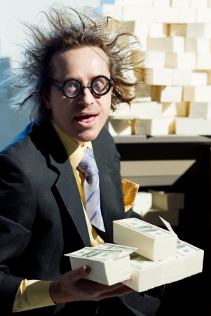 Greedy banker with bunch of money Stock Photo - 22853550