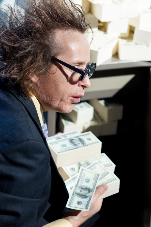 Greedy banker with bunch of money Stock Photo - 22853551