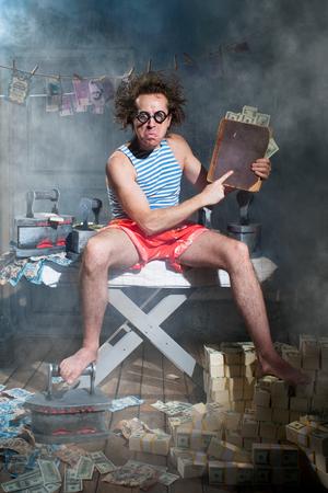 miser: Greedy millionaire keeps money at home Stock Photo