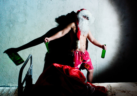 Cheerful Santa Claus is celebrates Christmas photo