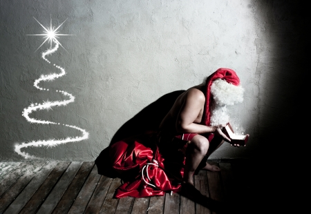 Funny Santa Claus holding a gift  photo