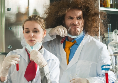 Crazy chemists conduct a scientific experiment in a laboratory photo