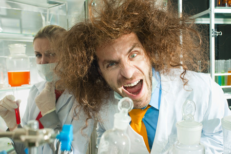 Crazy chemists are in a laboratory photo