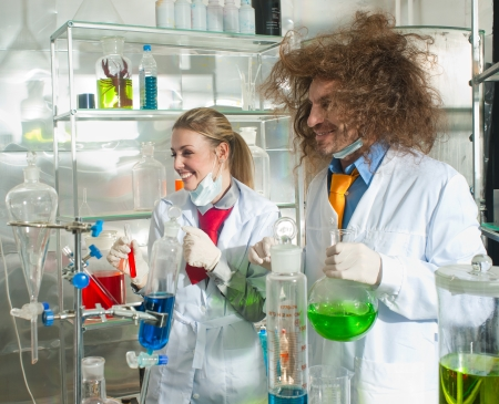 Cheerful chemists are in a laboratory photo