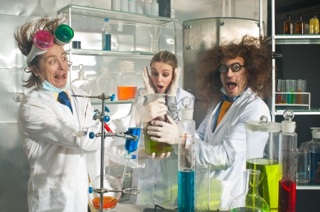 Bizarre chemists are in a laboratory Stock Photo
