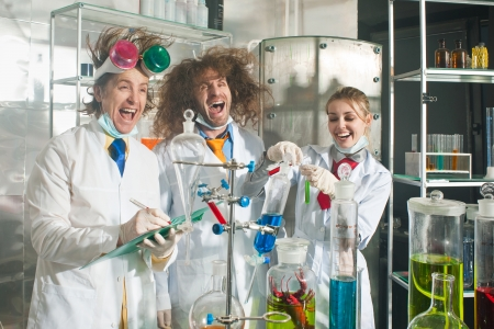 Cheerful chemists are in a laboratory Stock Photo
