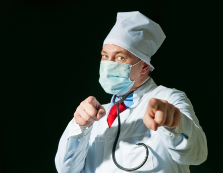 Doctor wearing a mask from the flu with stethoscope photo