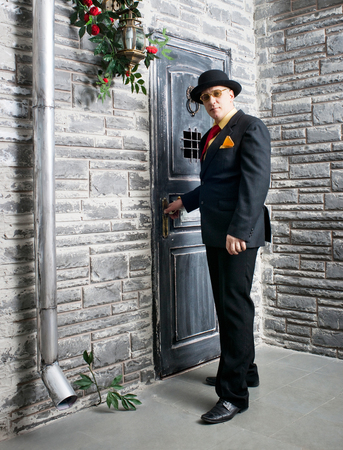 lodger: Man in black suit near the door
