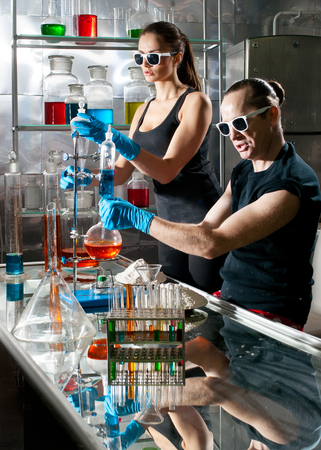 Chemists conduct research in a lab photo