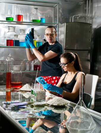 Drug manufacturers with weapons in the lab