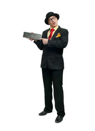 Funny man in black suit with keyboard photo