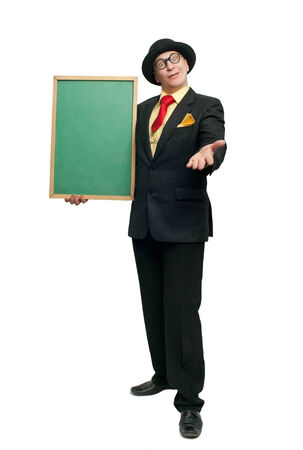 Cheerful man in black suit with blackboard photo