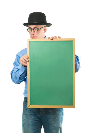 Serious man in blue shirt with a blackboard photo