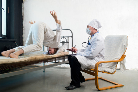 Doctor and crazy patient in a hospital