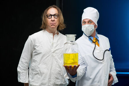 Doctor and patient holding a bottle medicine