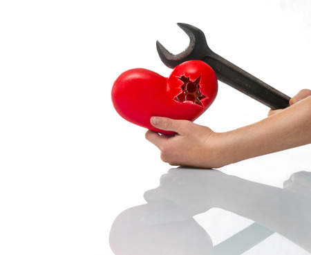 faithlessness: A broken heart in his hand and wrench