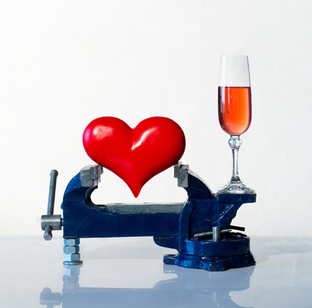 vice grip: Heart is grip in a vice and wineglass