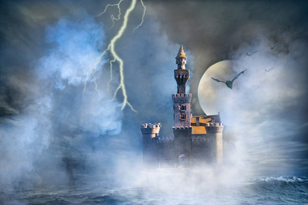 Old fantasy castle with the bats and lightning photo