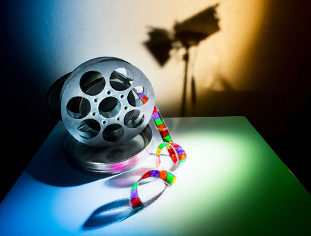 Reel of film on a wall background photo