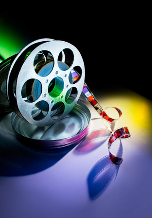 Reel of film on a color background photo