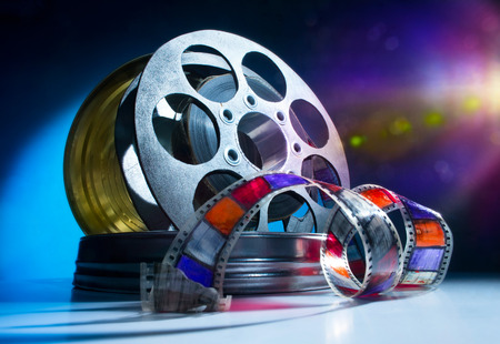 film reel: Reel of film on a color background Stock Photo