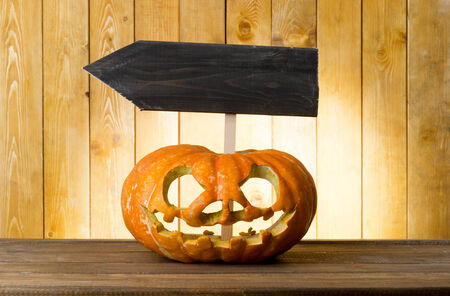 Halloween pumpkin on the wood table photo