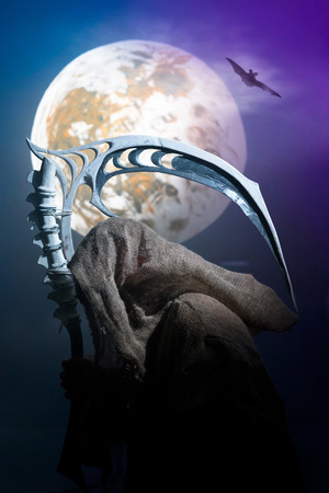 Ghost in rags with scythe on the background of the moon Stock Photo