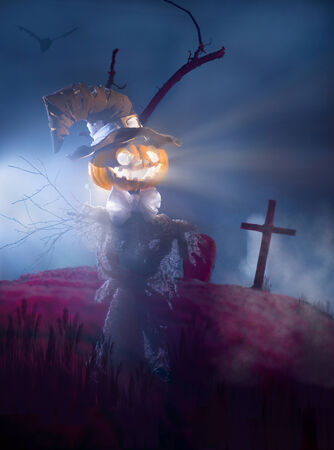 bugaboo: Scarecrow with head of pumpkin on the cemetery