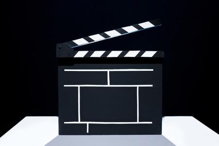 cinematographer: Cinema clapper on the black background