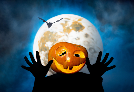 Halloween man-pumpkin on the moon background photo