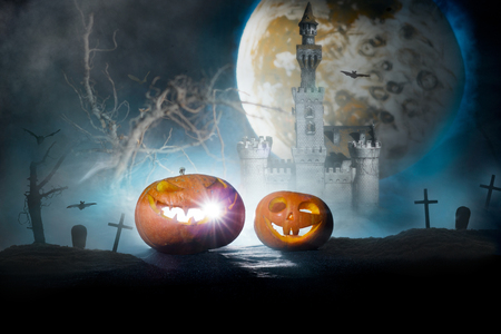 Halloween pumpkin on the night landscape photo