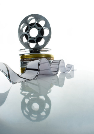 Reel and strip of the film on a white background photo
