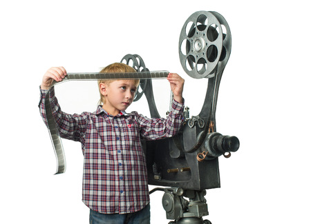 Little boy with a film projector photo