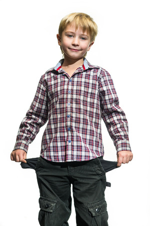 Sad boy stands with empty pockets