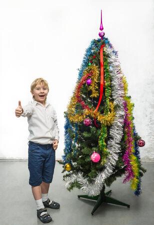 Little boy near the Christmas tree photo