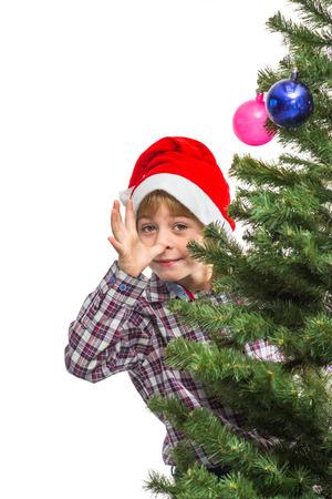 Little Santa near the Christmas tree photo