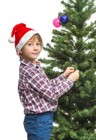 Little Santa decorates the Christmas tree photo