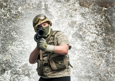 Soldier in camouflage with a weapon photo