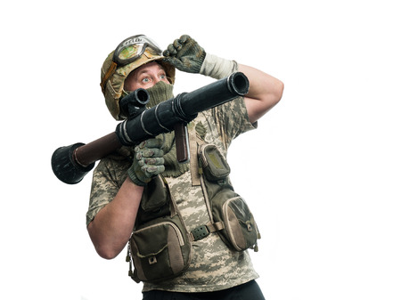regular people: Soldier in camouflage with a weapon
