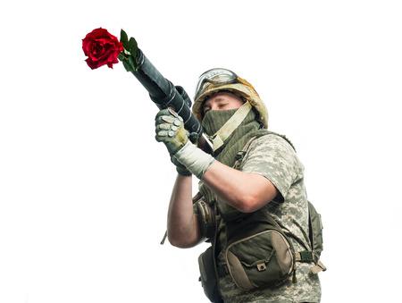 Bizarre soldier shoots a weapon rose photo
