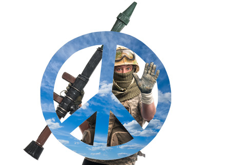 Soldier with a weapon and symbol of pacifism