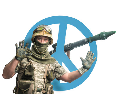 peacemaker: Soldier with a weapon and symbol of pacifism