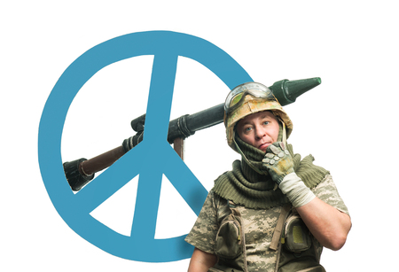 pacifism: Soldier with a weapon and symbol of pacifism
